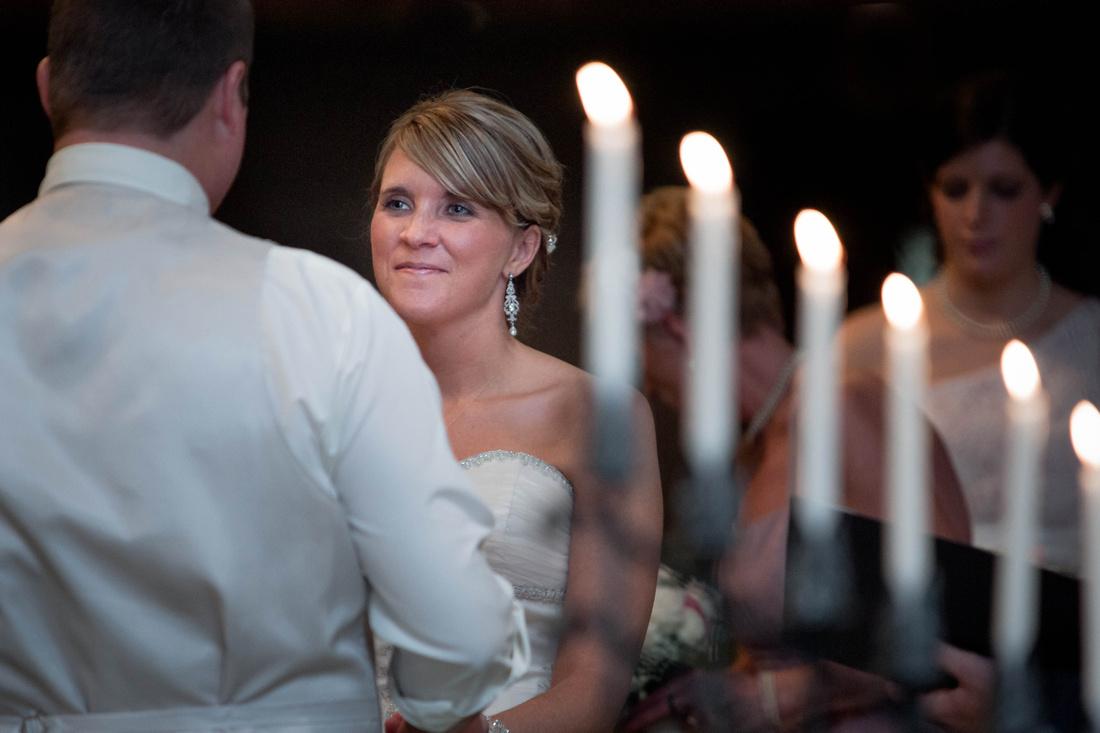 Wedding Photography. bride looking at groom.