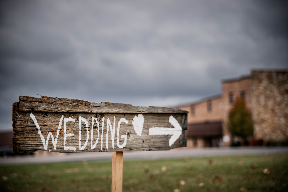 Wedding Photography. wedding sign pointing to church.