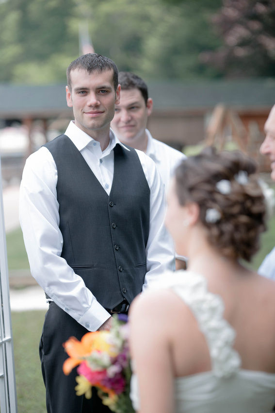 Groom looking at bride as dad walks her down the isle. Johnstown PA wedding photography.
