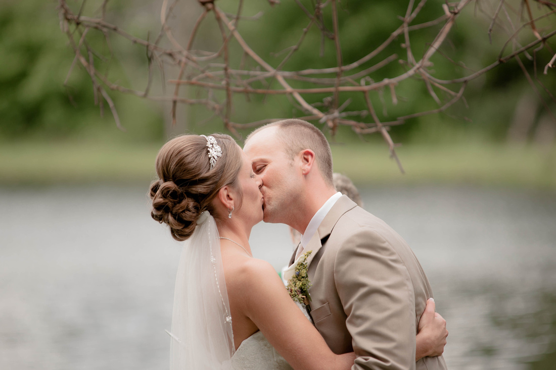 Bride and groom kissing after they are pronounced man and wife. Somerset PA wedding photography.