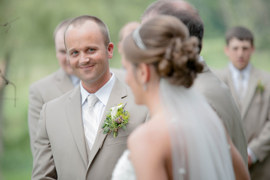 Groom looking at bride as dad walks her down the isle. Somerset PA wedding photography.