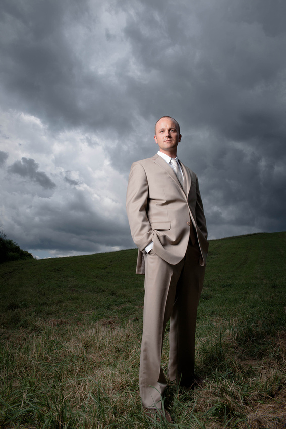 Groom standing with cloudy sky in background. Somerset  PA wedding photography.
