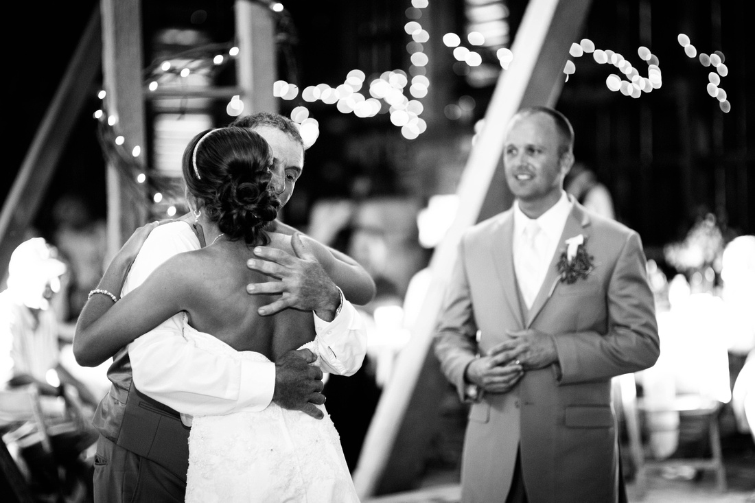 Bride dancing with father at reception as groom looks on. Somerset PA wedding photography.