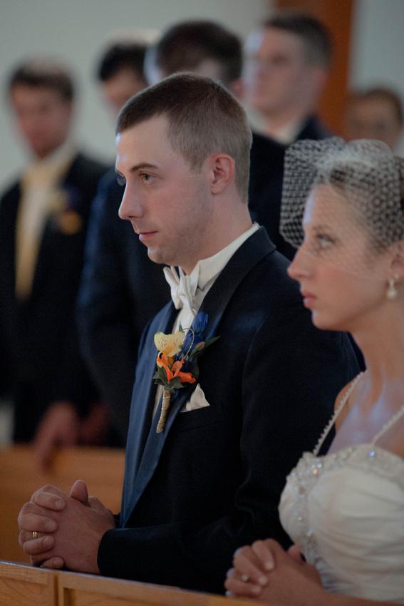 Bride and groom neeling during wedding ceremony. Johnstown PA wedding photographer.