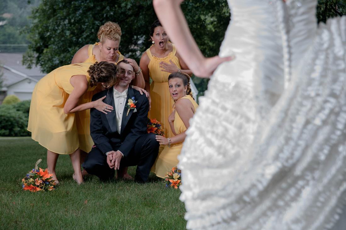 Amusing wedding photo of brides maids flirting with groom. Johnstown PA wedding photographer.