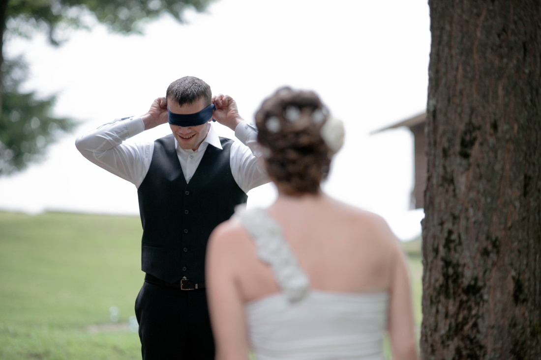 First look groom with blind fold. Johnstown PA wedding photography.