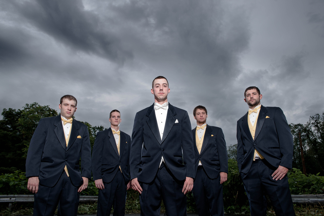 Groom and grooms men standing with sky behind them. Johnstown PA wedding photographer.