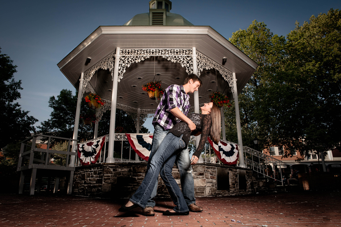 engagement portrait of couple in front of gaziebo or band stand in Ligonier pa. Ligonier pa engagement photography.