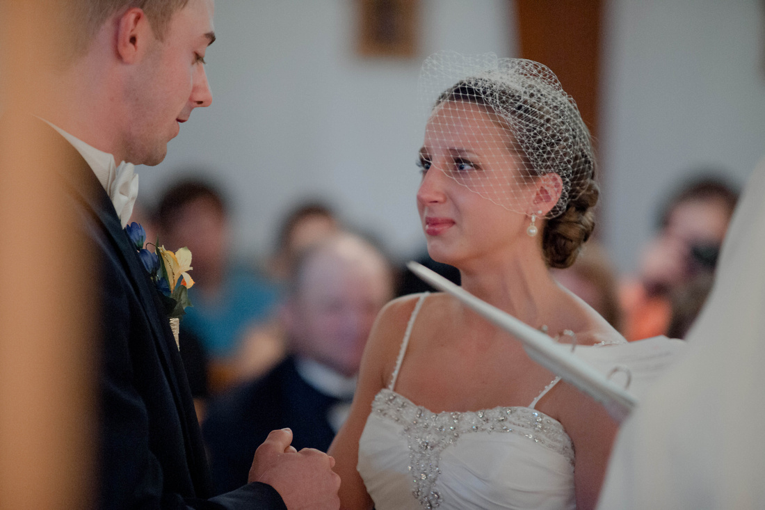 Bride trying not to cry while groom says vows. Johnstown PA wedding photographer.