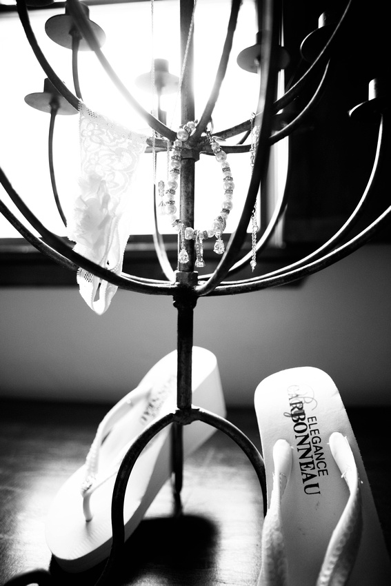 Brides jewelry hanging on candle holder. Somerset PA wedding photography.