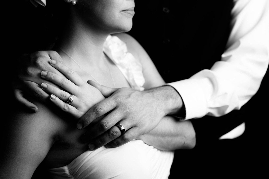 Portrait of bride and groom with rings. Johnstown PA wedding photography.