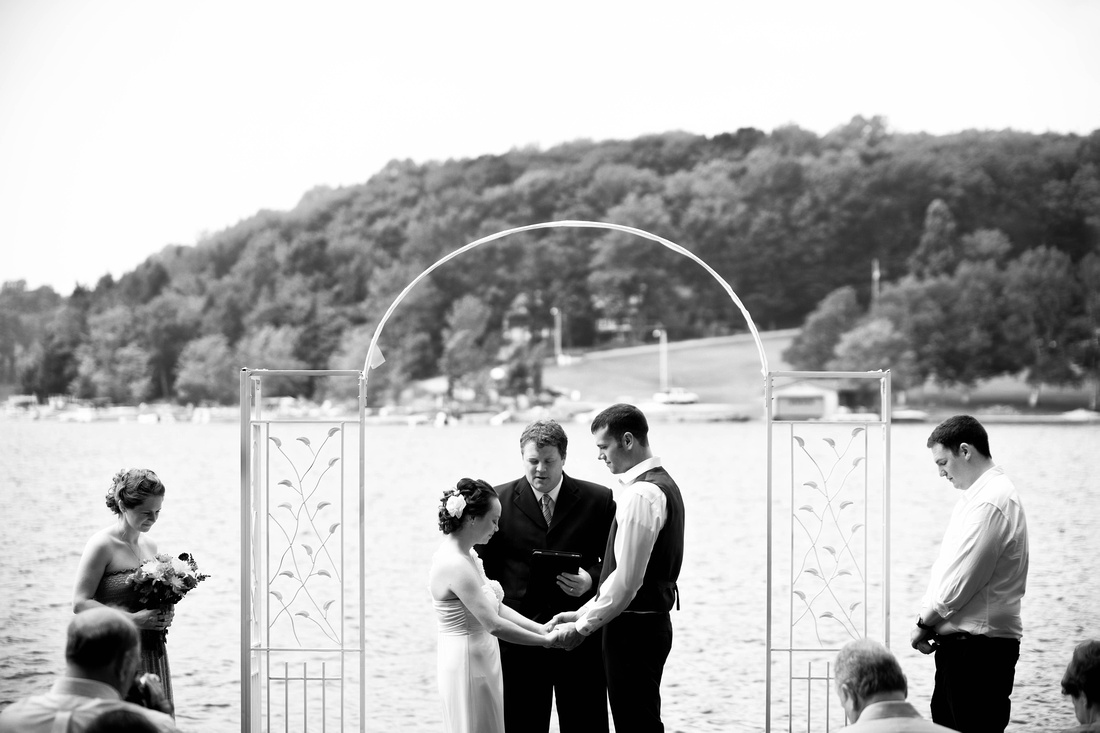Bride and groom holding hands overlooking lake. Johnstown PA wedding photography.
