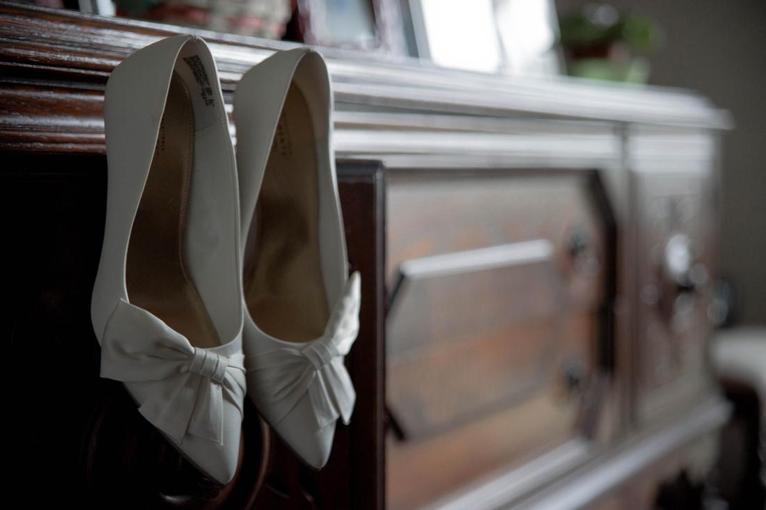 Brides shoes hanging on dresser. Johnstown PA wedding photographer