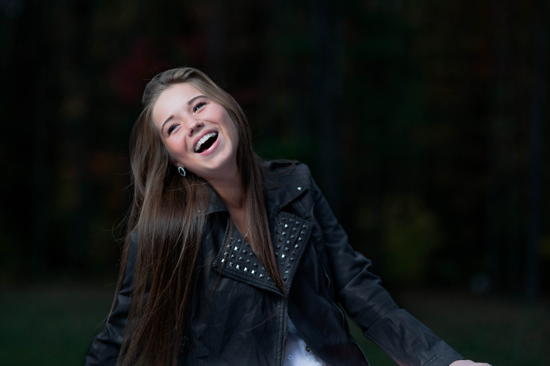 Senior Portrait Photography. Young woman laughing.