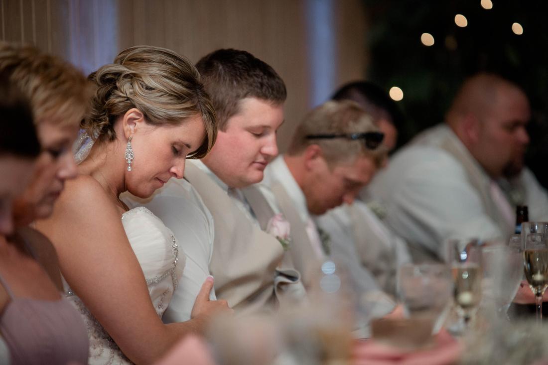 Wedding Photography, praying at the bridal table