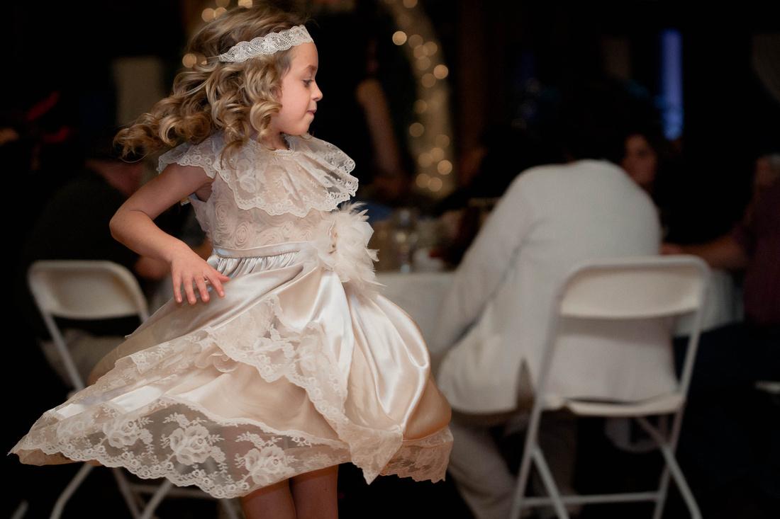 Wedding Photography, little girl dancing.