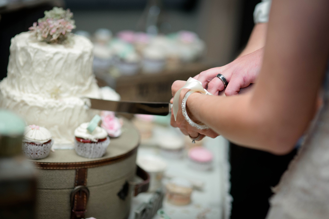 Wedding Photography. bride and groom cutting cake