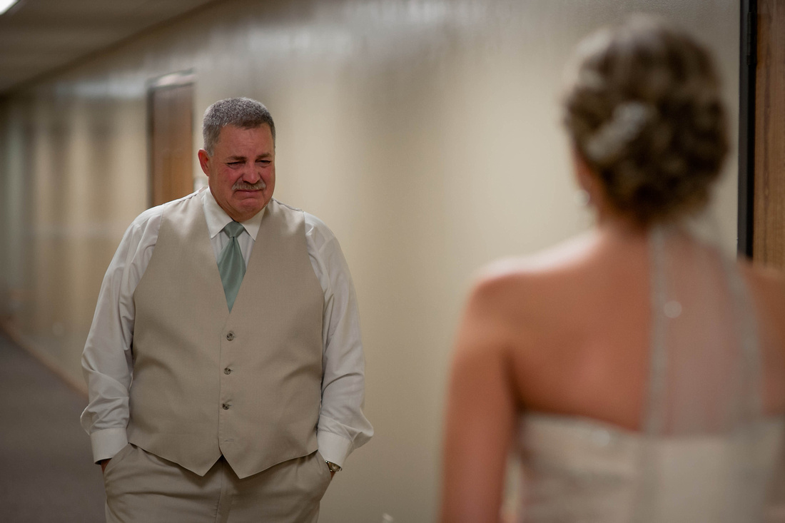 Wedding Photography father sees bride for the first time.