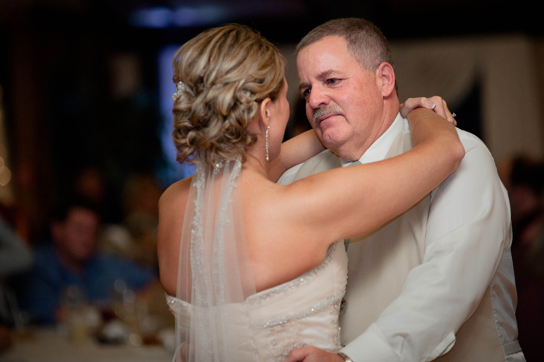 Wedding Photography, bride dancing with father.