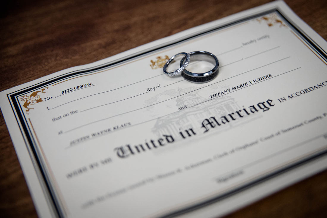 Wedding Photography. marriage certificate with wedding rings